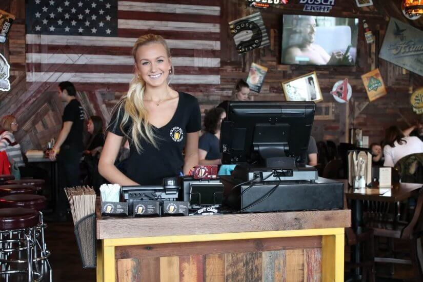 crooked pint employee smiling for fundraiser event